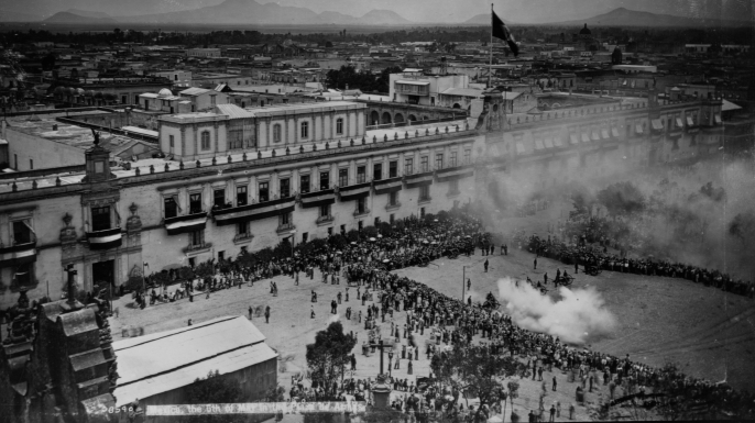 A crowd of spectators gathers in a city's Plaza de Armas for an artillery salute for Cinco de Mayo. The holiday celebrates Mexico's victory over the French. Mexico.   (Photo by Detroit Photo Company/Library of Congress/Corbis/VCG via Getty Images)