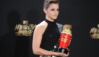 Emma Watson poses in the press room at the 2017 MTV Movie and TV Awards.  (Credit: Jason LaVeris/FilmMagic)