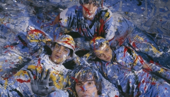 "Manchester rock group The Stone Roses in a paint-spattered abstract expressionist romp. Formed in Manchester in 1983, they were pioneers of the ""Madchester"" movement. (Credit: Kevin Cummins/Getty Images)"