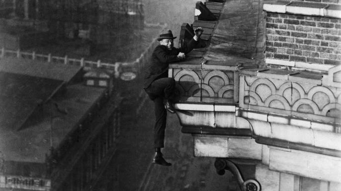 The climber, better known as the Human Fly, climbing on the front of a tower building. (Credit: Gircke/ullstein bild/Getty Images)