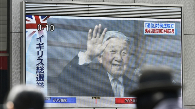 A large screen in Osaka's Dotombori area in western Japan shows footage from a television news program reporting the parliament's enactment of a law on June 9, 2017.