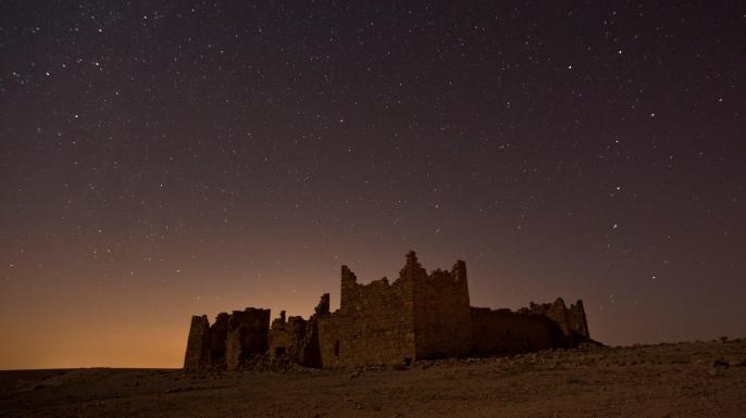Ancient Roman built fortress Qasr Bashir under stars.