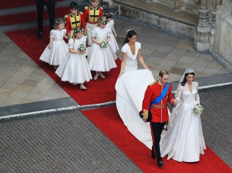 Their Royal Highnesses Prince William, Duke of Cambridge and Catherine, Duchess of Cambridge following their marriage at Westminster Abbey on April 29, 2011. (Credit: Dave Cannon/GP/Getty Images)