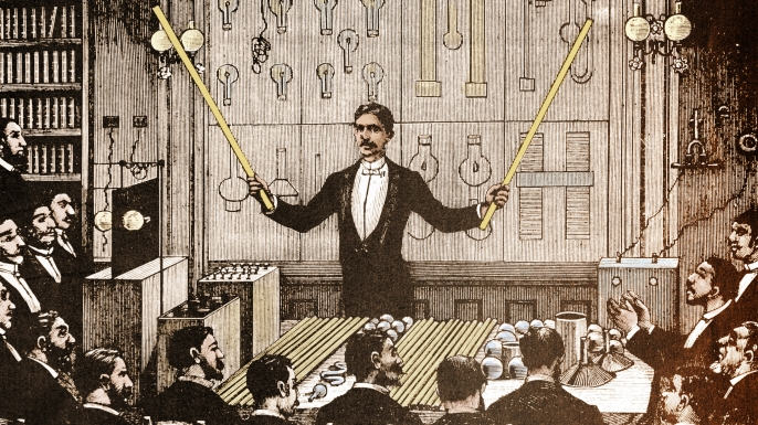 Nikola Tesla demonstrating alternating current electricity.