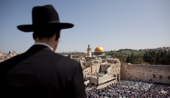 Thousands of Israelis attend the Annual Cohanim prayer, or Priest's blessing, for the Passover holiday at the Western Wall in Jerusalem's old city. Thousands of Jews make the pilgrimage to Jerusalem during Passover, which commemorates the Israelites' exodus from Egypt some 3,500 years ago.  (Credit: Uriel Sinai/Getty Images)