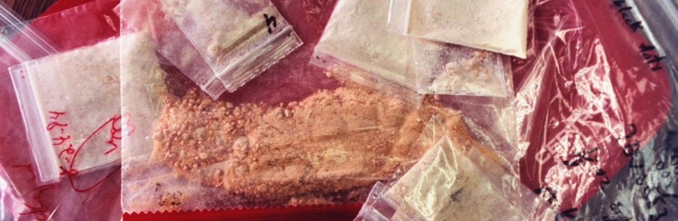 Plastic bags of crank (methamphetamine) in police custody after drug bust.  (Credit: William F. Campbell/The LIFE Images Collection/Getty Images)