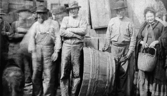 Irish clam diggers on a wharf in Boston, 1882. (CORBIS/Corbis via Getty Images)