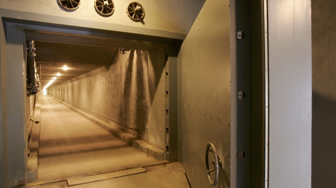 """A view of the West Tunnel Blast Door, which weighs 25 tons and serves as an entrance to a former government relocation facility codenamed """"Project Greek Island"""". This 112,000 square-foot shelter was constructed beneath the Greenbrier Resort's West Virginia Wing, to serve as a relocation site for members of the U.S. Congress and associated staff in the event of a nuclear attack on the U.S. soil.   (Credit: Alex Wong/Getty Images)"""