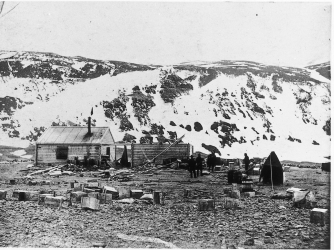 The huts as photographed on the arrival of the Scott's Discovery expedition at Cape Adare in 1902. (Credit: Antarctic Heritage Trust)