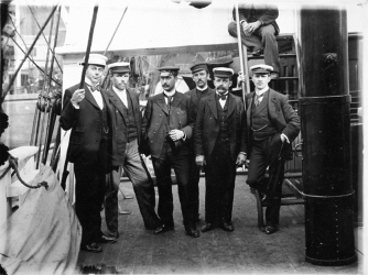 The scientific staff on the ship before sailing south from Australia. From left: Nicolai Hanson, William Colbeck, Herlof Klovstad, Anton Fougner, Louis Bernacchi. (Credit: Antarctic Heritage Trust)