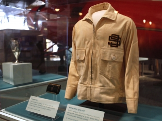 "A flight suit jacket designed by Amelia Earhart is seen on display at the Smithsonian's National Air and Space Museum in Washington, in the ""Pioneers of Flight"" gallery. The jacket is from a suit called the ""Ninety-Nines Flying Suit."" (Credit: AP Photo/Jacquelyn Martin)"