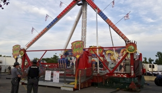 Authorities stand near the Fire Ball amusement ride after it malfunctioned, injuring several at the Ohio State Fair, Wednesday, July 26, 2017, in Columbus, Ohio. (Credit: Jim Woods/The Columbus Dispatch via AP)