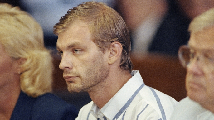 Jeffrey Dahmer at his initial appearance at the Milwaukee County Circuit Court, where he was charged with four counts of first-degree intentional homicide, July 26, 1991.  Dahmer was arrested after police found the body parts of 11 men in his Milwaukee apartment.  (Credit: AP Photo/Charles Bennett)