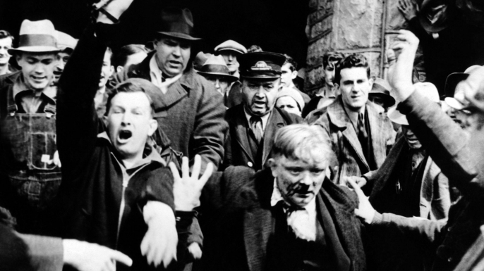 'Sit-Down Strikers' were beaten by a mob of non-striking workers and local farmers. (Credit: Everett Collection Historical/Alamy Stock Photo)