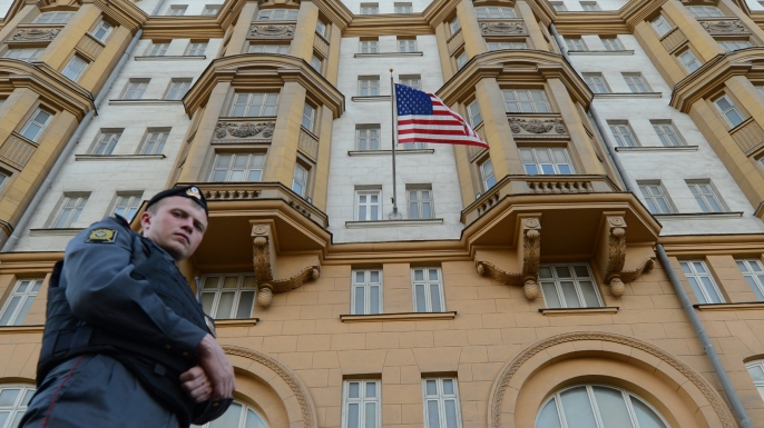A Russian police officer patrols a street in front of the US Embassy  in Moscow, the headquarters of US Agency for International Development.    (Credit: Kirill Kudryavtsev/AFP/GettyImages)