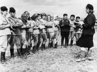 "Women pilots of the ""Night Witches"" receiving orders for an up-coming raid. (Credit: Sovfoto/UIG via Getty Images)"