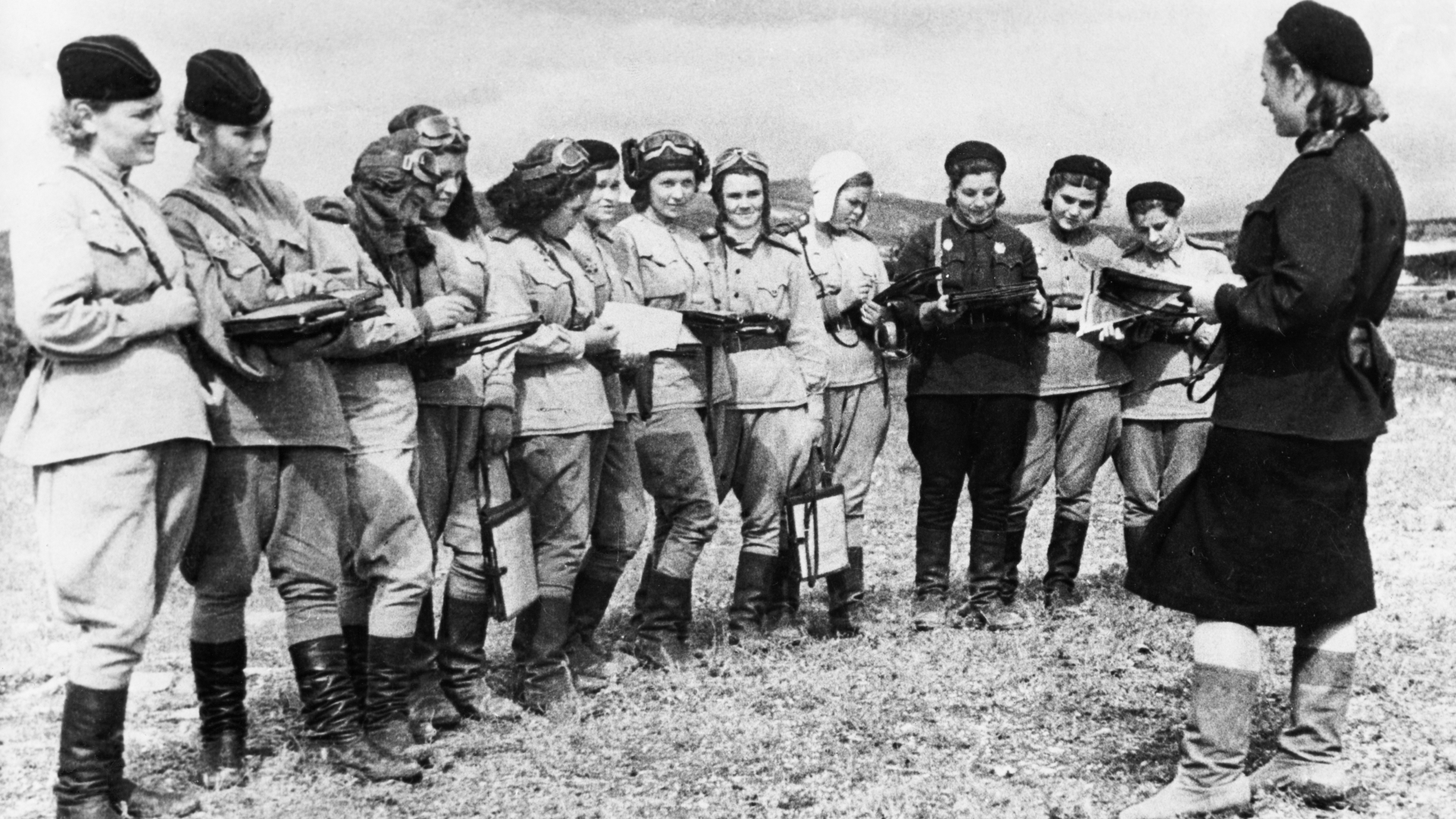 """Women pilots of the """"Night Witches"""" receiving orders for an up-coming raid. (Credit: Sovfoto/UIG via Getty Images)"""