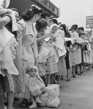 Mothers waiting in line with their children outside the Queen for a Day program.  (Credit:Ralph Crane/The LIFE Picture Collection/Getty Images)