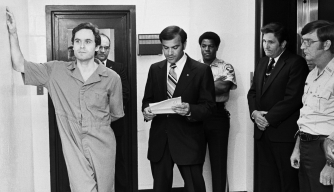 Theodore (Ted) Bundy in Leon County jail as the indictment charge is read, charging him with the murders of two FSU students at the Chi Omega house. (Credit: Bettmann/Getty Images)