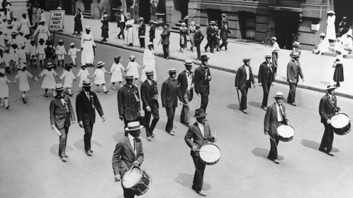 Protest parade down Fifth Avenue after the recent East St. Louis riots. (Credit: George Rinhart/Corbis via Getty Images)