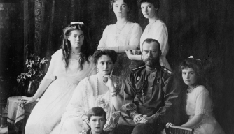 Czar Nicholas and his wife, Alexandra, pose with their children.