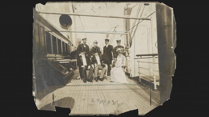 Photograph showing President Theodore Roosevelt, seated center, Secretary of the Navy William H. Moody, left, Mrs. Roosevelt, right; standing Sir Thomas Lipton, Admiral George Dewey, C. Oliver Iselin, and General Adna R. Chaffee on the deck of the Mayflower off Oyster Bay, Long Island, New York, 1903. (Credit: The Library of Congress)