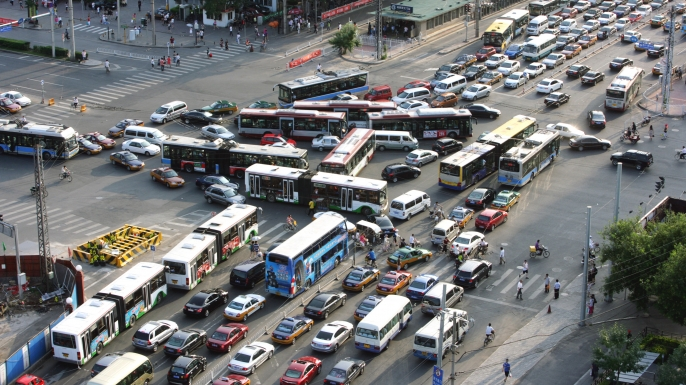 Masses of vehicles move slowly in a traffic jam at a crossroad in Beijing, China, August 6, 2010. (Credit: ImagineChina via AP Images)
