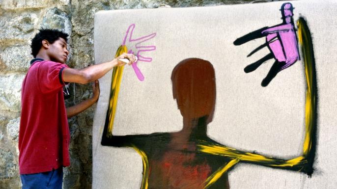 Artist Jean-Michel paints in St. Moritz, Switzerland,1983. (Credit: Lee Jaffe/Getty Images)