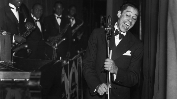 American  jazz band leader and singer Cab Calloway at the Trocedero in London. (Credit: Fox Photos/Getty Images)