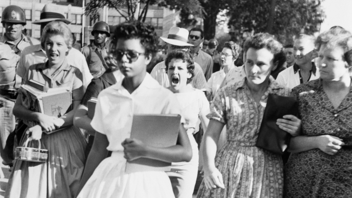 Elizabeth Eckford on her first day of school. She was one of the nine students whose integration into Little Rock's Central High School was ordered by a Federal Court following legal action by NAACP. (Credit: Bettmann/Getty Images)