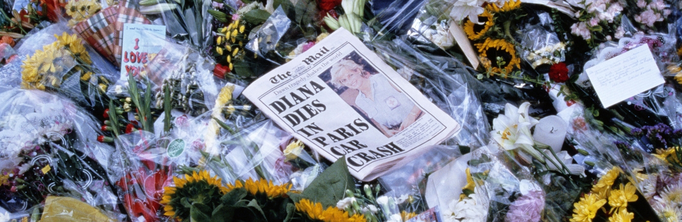 Copy of The Daily Mail newspaper on a sea of flowers at the memorial for Princess Diana in front of Buckingham Palace. (Credit: Robert Wallis/Corbis via Getty Images)