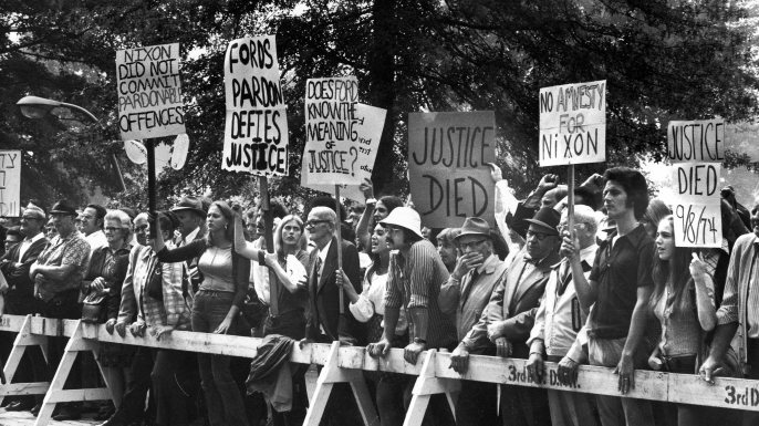 Protestors opposed to President Gerald Ford's pardon of former President Richard Nixon after the Watergate affair. (Credit: Bill Pierce/The LIFE Images Collection/Getty Images)