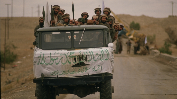 As part of their war against the Soviet forces invading Afghanistan, the Mujahidin, anti-Communist troops trained and supplied by the U.S.A., Saudi Arabia, Pakistan and other countries, have launched an offensive in the Jalalabad area. Pictured here is a truck full of armed Mujahidin soldiers arriving at the Samarkhel Mujahidin camp near the Jalalabad airport to back up the forces already present . (Credit: Patrick Durand/Sygma via Getty Images)