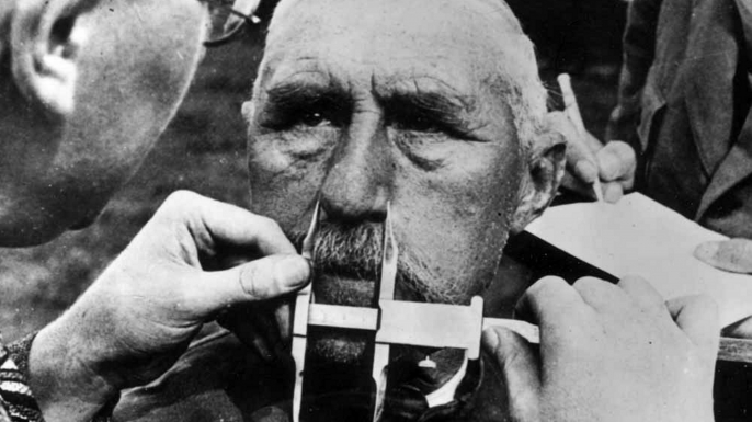 A man having his nose measured during Aryan race determination tests under Nazi Germany's Nuremberg Laws. (Credit: Universal History Archive/UIG via Getty Images)