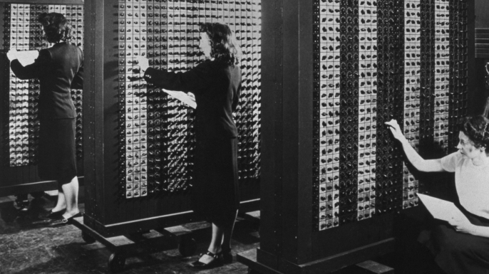 Computer operators program ENIAC, the first electronic digital computer. (Credit: Corbis via Getty Images)
