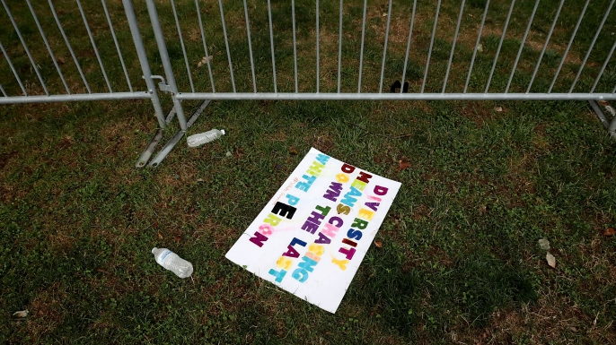 Signs left behind by white nationalists, neo-Nazis, the Ku Klux Klan and members of the 'alt-right' the day after the Unite the Right rally devolved into violence August 13, 2017 in Charlottesville, Virginia. The Charlottesville City Council voted to remove the statue and change the name of the space from Lee Park to Emancipation Park, sparking protests from racist groups. (Credit: Chip Somodevilla/Getty Images)