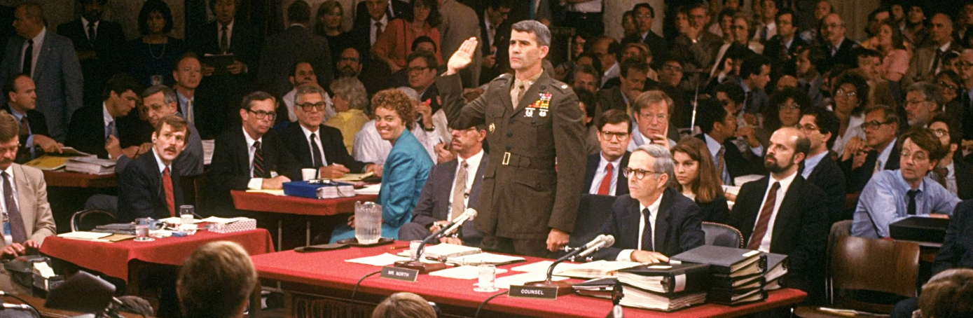 Former NSC staffer Lieut. Col. Oliver North swearing in to testify during Iran-contra hearings, with his attorney Brendan Sullivan.  (Credit: Terry Ashe/The LIFE Images Collection/Getty Images)