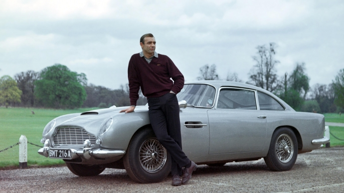 Sean Connery as James Bond with the Aston Martin in Goldfinger. (Credit: AF Archive/Alamy Photo)