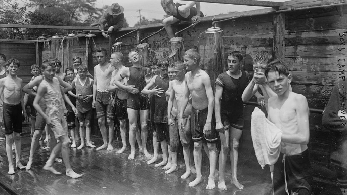 Boys taking a shower at the summer military training camp for boys at Peekskill, New York, 1917. (Credit: The Library of Congress)
