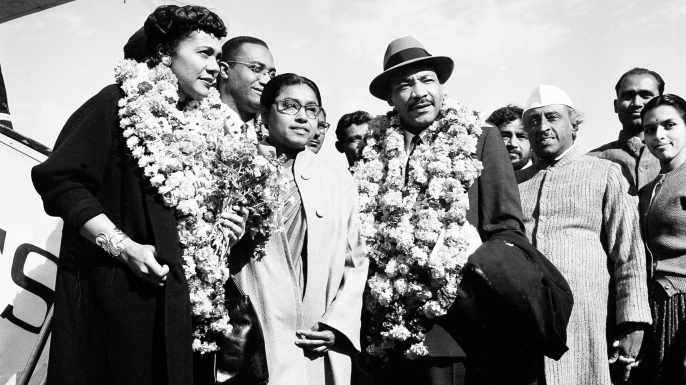 "Dr. Martin Luther King, Jr. and his wife Coretta after landing at the airport in New Delhi, India. King, who is known here as the American Gandhi, flew here on what he calls a ""four-week pilgrimage in India which to me means Mahatma Gandhi"". (Credit: R. Satakopan/AP/REX/Shutterstock)"