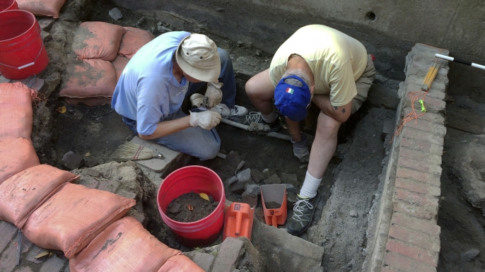 Boston Archaeological Program volunteers Tim Riordan and Bob Sartini excavate a site that experts believe may have contained an outhouse used by Paul Revere, September 28, 2017. (Credit: William J. Kole/AP Photo)