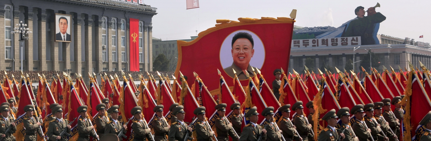 North Korean soldiers march with a portrait of late North Korean leader Kim Jong Il during a massive military parade in Pyongyang's Kim Il Sung Square to celebrate 100 years since the birth of North Korea's founder Kim Il Sung, 2012.  (Credit: Ng Han Guan/AP Photo)