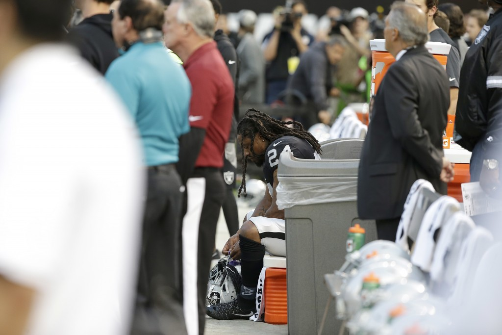 Oakland Raiders running back Marshawn Lynch sits on the bench during the national anthem before an NFL preseason football game, August 19, 2017. (Credit: Rich Pedroncelli/AP Photo)