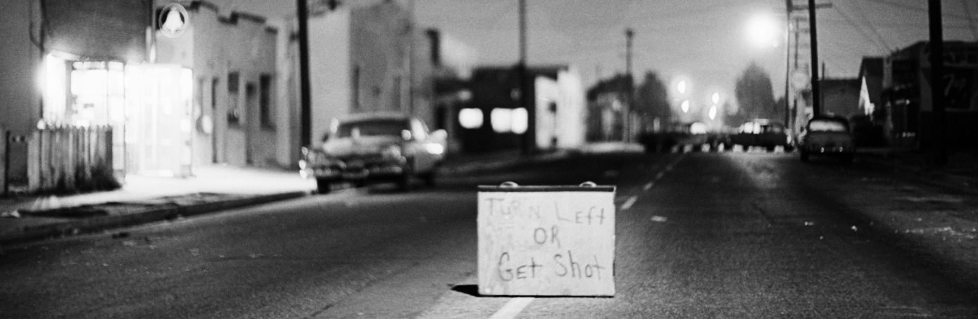 A sign put up during the Watts riots in the district of Los Angeles, 1965. (Credit: Bettmann/Getty Images)