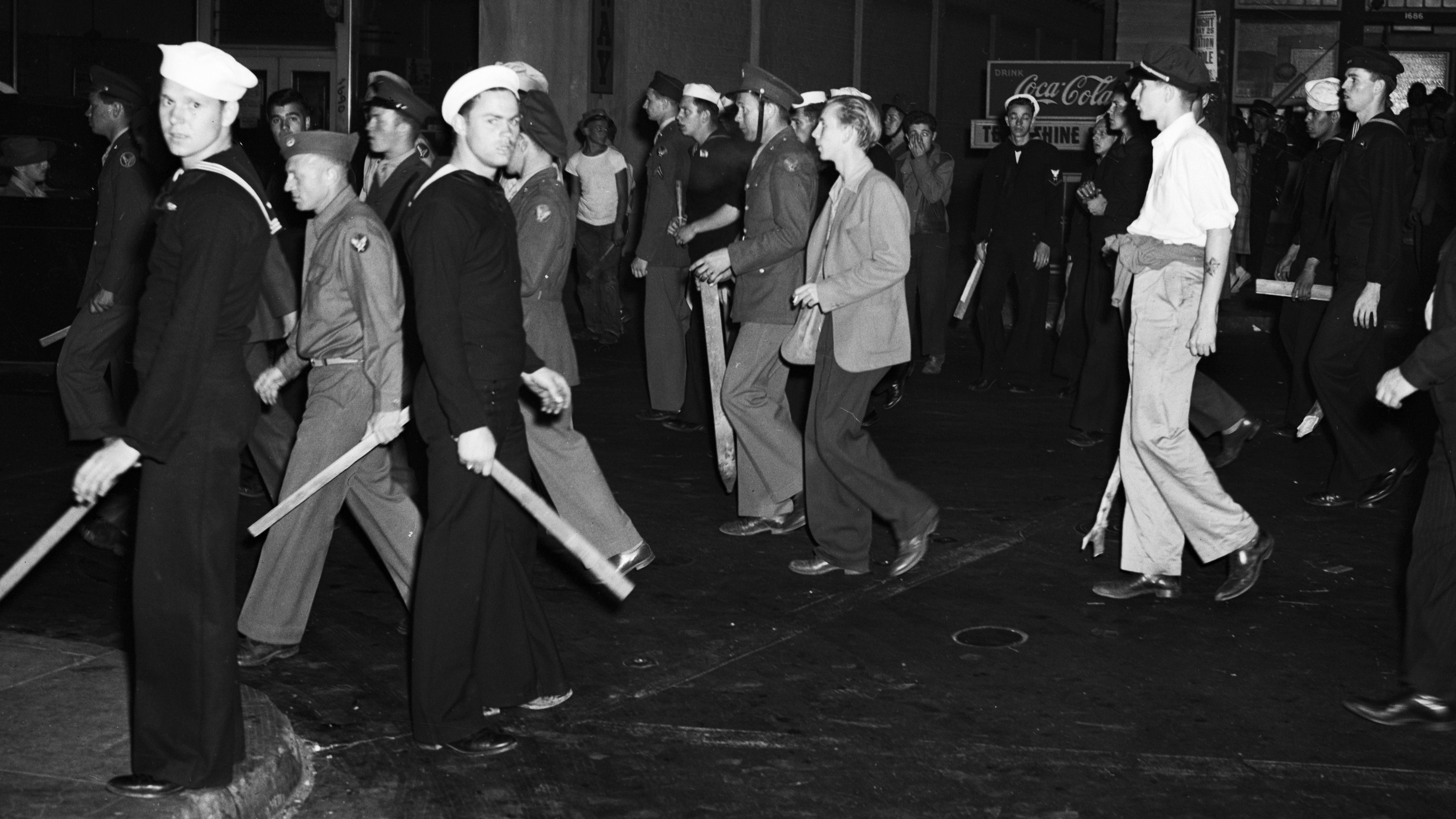 Armed with clubs, pipes and bottles, this self-appointed posse of uniformed men was all set to settle the Zoot Suit War when the Navy Shore Patrol stepped in and broke it up. (Credit: Bettmann/Getty Images)