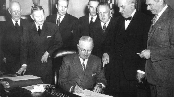 President Truman signs the Economic Assistance Act, a program for the reconstruction of Europe, known as the Marshall Plan. (Credit: Photo12/UIG via Getty Images)