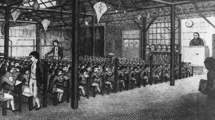 Senior boys instructing their juniors at a school under Joseph Lancaster's Monitorial System in the East End of London. (Credit: Rischgitz/Getty Images)