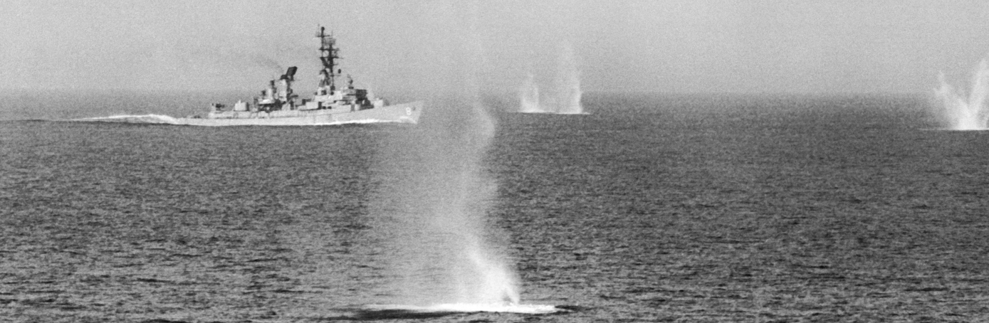 The guided missile destroyer USS McCormick is fired upon by North Vietnamese shore batteries as it patrols in the Gulf of Tonkin, 1967. (Credit: Underwood Archives/Getty Images)