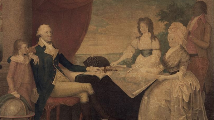 George Washington with Martha Washington and her two grandchildren. The servant in the corner is thought to be William Lee, the only slave of Washington to be immediately granted freedom. (Credit: The Library of Congress)