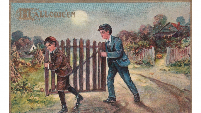 Vintage card showing two boys stealing a gate on Halloween night, 1911. (Courtesy of Lisa Morton)